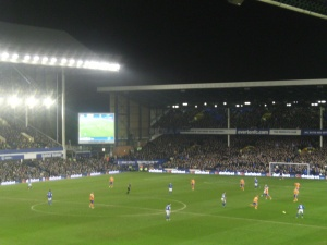 Everton (blue) and Oldham compete at Goodison Park