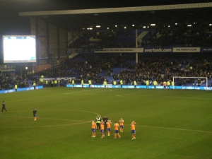Oldham Athletic players applaud their fans after the game